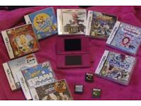 Pink Dsi with charger and games great condition