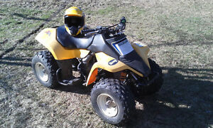 Great Kids Quad ready to go with a helmet