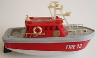 Vintage battery-operated fire engine boat in working condition
