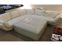 White large leather sofa and Xxl puffe