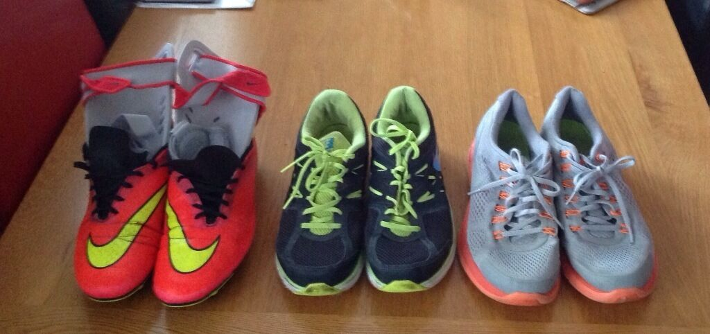 Two pairs of Nike trainers plus footy boots ( Nike ) plus shin pads. Size 11 .