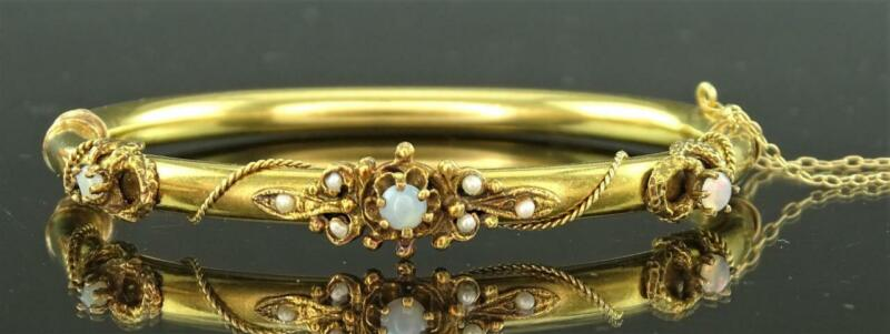 A RARE VICTORIAN 14K YELLOW GOLD, OPAL & SEED PEARL HINGED BANGLE BRACELET c1880