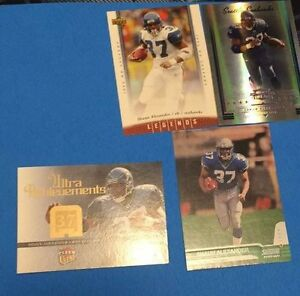 4 Shaun Alexander Football Cards - 1 Rookie - 3 Inserts