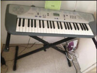Casio keyboard with stand and music book good condition
