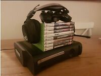 Xbox 360 with controller. Headset and EIGHT games