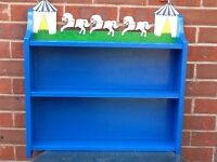 Children's shelves with circus theme cutout.