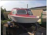 Micro-plus cruiser, comes with 50hp evinrude engine, on a stainless steel trailer.