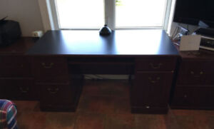Double pedestal desk and two filing cabinets in cherry finish