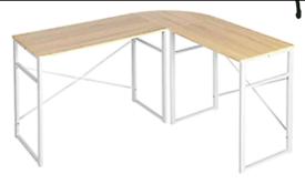 A new stylish oak effect wooden top with white mettle corner desk .