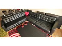 Beautiful, comfortable, Ikea black leather L shaped couch with removable head-rests.
