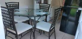 Round glass table with 4 chairs