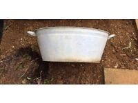 Two medium sized vintage galvanised wash tubs ideal for garden planters.