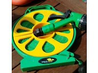 Flat hose on a reel, 15 meters approximately.