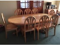 Oval pine table and 8 chairs