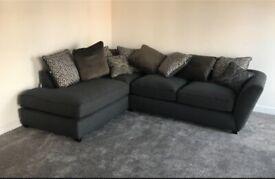 Dark grey sofa with cushions