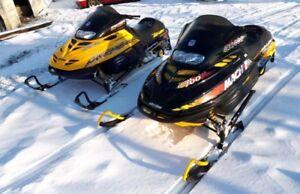 2 ski doos with trailer