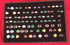 Joblot of 84 costume jewellery rings and velvet Stand