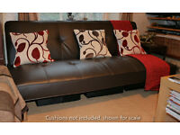 Chocolate brown faux leather 'click clack' style of bed settee / sofabed in excellent condition