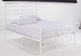 Metal bed, swirl design, with deep thick, mattress.