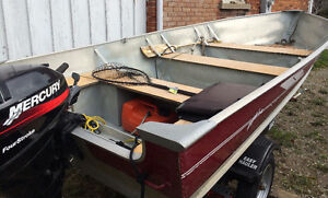 14 ft Lund 9.9 mercury, new Easy Haul trailer.