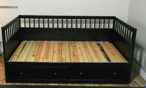 IKEA bedframe with two storage drawers.