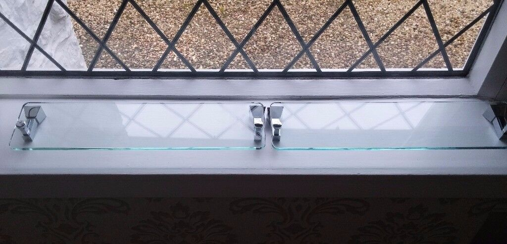 Top quality glass and chrome shelves x 2. Conclealed wall fittings included.