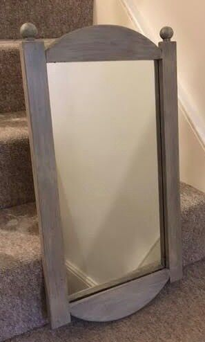 A 63x35cm Mirror with 'shabby chic' stained frame