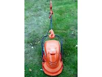 Flymo. Mow n Vac electric grass cutter with collector in good working condition.