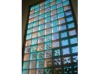 82 glass bricks / blocks , mainly clear but some blue & green- bathroom or garden feature wall