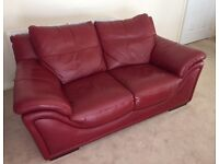 Two dark red leather two-seater sofas in great condition.