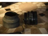 Pentax-A 50mm 1:1.7 lens + skylight filter, lens caps rear and front and hood. Excellent condition