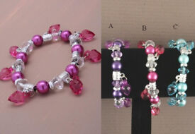 Assorted coloured bead stretch bracelet with heart bead charms. In Pink/lilac and blue. - JTY014