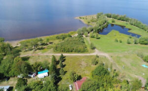2 bedroom bungalow with potential water views, one acre of land
