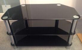 BLACK GLASS 3 SHELVES TV UNIT WITH CHROME LEGS. GCC.