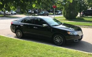 2012 Lincoln MKZ with snow tires on rims