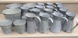 Galvanised flower jugs and tubs for wedding tables