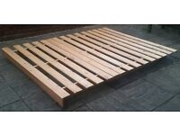 """King size low level bed frame, pine wood. 203cm x 152.5cm (80"""" x 60""""). In excellent condition."""