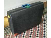 Carlton rigid, full size suitcase with wheels