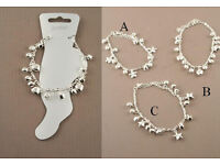 Silver coloured anklet with either hearts, stars or flower charms and bells - JTY002