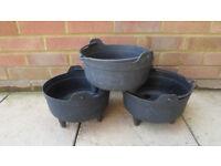 Three plastic cauldron shaped plant pots