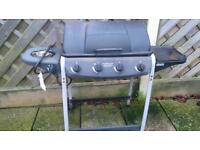 Gas barbecue and burner