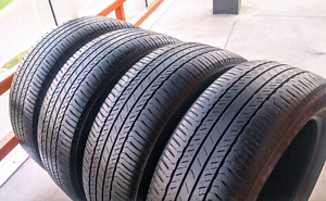 Set of four 235/55/19 Bridgestone Dueler all season tires