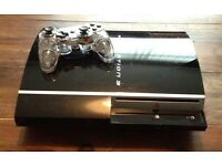 PS3 with wireless controller and 9 games