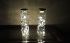 2 Beautiful tall glass jars with white string lights