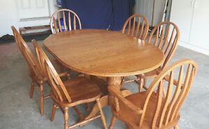Solid Oak Table with 6 matching chairs for sale