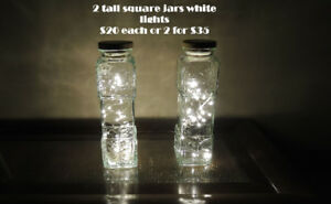 Beautiful tall glass jars with white string lights