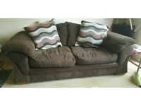 Two seater chocolate brown cord pillow back sofa