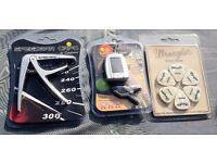 Guitarist Gift Pack. Speedbar Capo, Clip on Tuner, 12 Picks. Brand New in Packaging. RRP £40