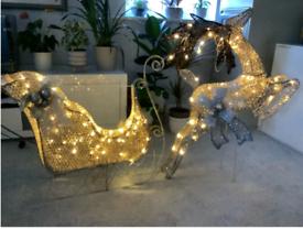 Large Reindeer and sleigh light up display.
