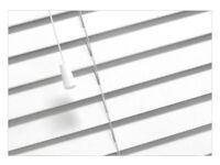 White wooden blinds